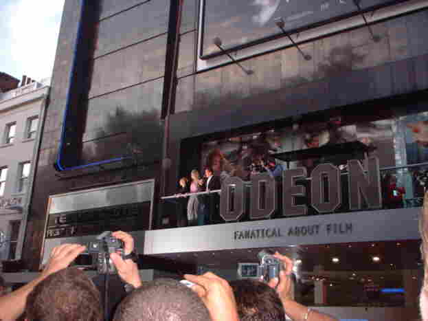 Arnold Schwarzenegger and cast on the Odeon balcony.