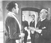 Louis Mazzini (Dennis                   Price) meets the hangman (Miles Malleson).